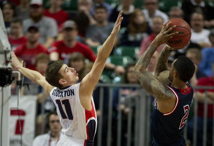 Gonzaga Bulldogs guard David Stockton (11) defends St. Mary's Gaels guard Paul McCoy (2) as he takes a shot during the second half of a WCC tournament semifinal men's college basketball game, Monday, March 10, 2014, in Las Vegas, Nevada. (Colin Mulvany)