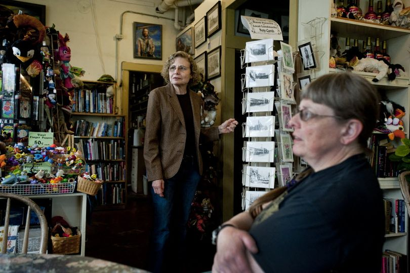 Bobbie Beese, left, and Betsy Mott are seen in their store on Tuesday at the Corner Door Fountain and Books in Spokane Valley. (Tyler Tjomsland)