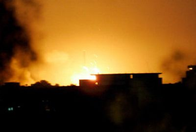 Explosions at a U.S. base's ammunition depot illuminated the sky over Baghdad early today.  A fire broke out  Tuesday night, setting off a series of explosions from detonating shells.   (Associated Press / The Spokesman-Review)