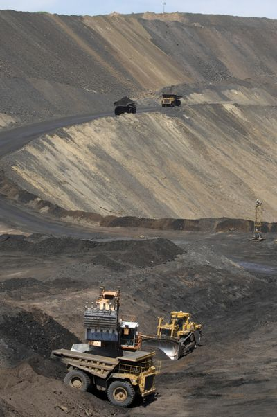 In this July 16, 2009, photo, phosphate ore is dug up and transported from Monsanto Company's South Rasmussen Mine site near Soda Springs, Idaho. U.S. land managers have approved a final plan for expanding an open-pit phosphate mine in southeastern Idaho proposed by Idaho-based J.R. Simplot Company. The U.S. Forest Service and U.S. Bureau of Land Management on Tuesday, July 28, 2020, approved the project that's expected to keep about 600 workers employed for another three years at Simplot's existing Smokey Canyon Mine and Don Plant processing facility in Pocatello.  (Bill Schaefer/Idaho State Journal)