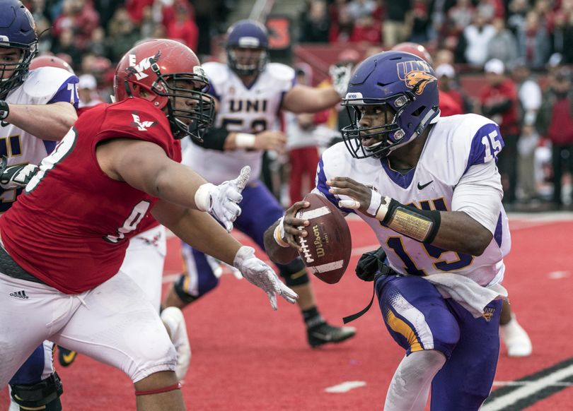 Eastern Washington DL Jay-Tee Tiuli tries to get a glove on Northern Iowa QB Aaron Bailey in the first quarter, Saturday, Sept. 17, 2016, in Cheney. (Dan Pelle / The Spokesman-Review)