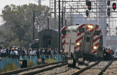 A Metra commuter train sits off the tracks after derailing Saturday in Chicago.   (Associated Press / The Spokesman-Review)