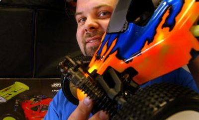 Matt Afana, owner of Performance R/C Hobbies, holds a Jammin X1 RC buggy at the store in Coeur d'Alene on Wednesday.   (Kathy Plonka / The Spokesman-Review)