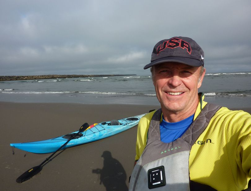 John Roskelley of Spokane prepares to launch his kayak on the Columbia River, which he measured at 1,200 miles.
