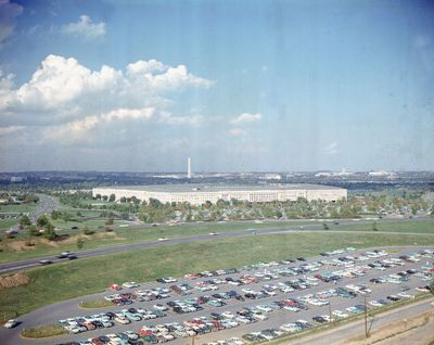 This undated file photo shows the Pentagon, headquarters of the U.S. Department of Defense, with the Washington Monument in background and a large parking lot in foreground, in Arlington, Va.  (STF)
