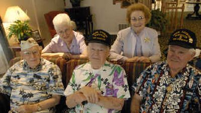 Charily Boyer, Sid Kennedy and Sandy Johnson have more than a shared WWII experience. All three married local girls and ended up back in Spokane.   (J. BART RAYNIAK / The Spokesman-Review)