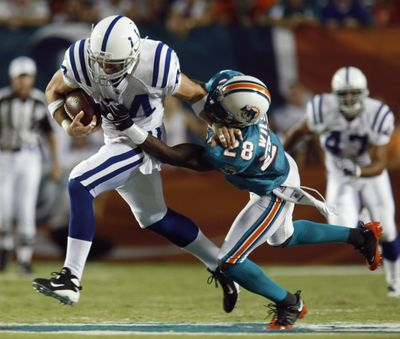 Colts tight end Dallas Clark shakes off a tackle on his way to a touchdown.  (Associated Press / The Spokesman-Review)