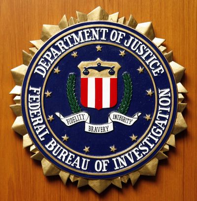 Logo of the Federal Bureau of Investigation of the Department of Justice of the United States of America pictured at the embassy of the USA in Berlin, Germany, Friday, Aug. 10, 2007. (MICHAEL SOHN / ASSOCIATED PRESS)