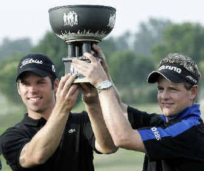Paul Casey, left, and Luke Donald of England won the World Cup Golf Championship and set off a small war of words when Casey questioned the tactics of American golfers and fans.   (Associated Press / The Spokesman-Review)