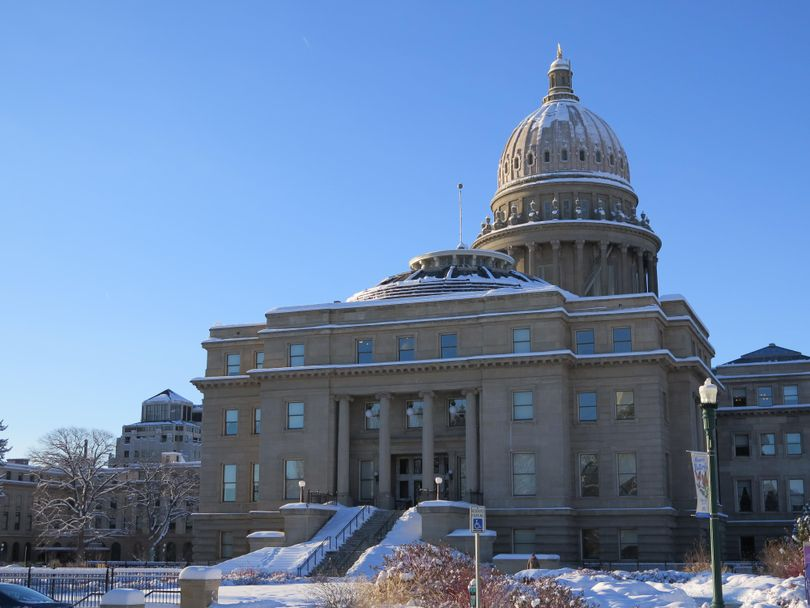 Idaho's state Capitol glistens under snow and cold blue skies on Thursday in Boise. Inside, lawmakers heard from experts and business leaders on prospects for the state's economy in the coming year. (Betsy Z. Russell)
