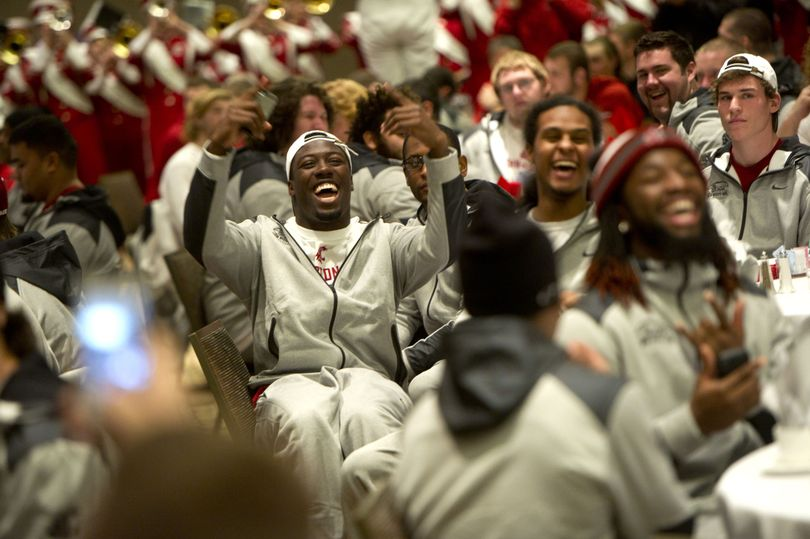 Washington State buck linebacker Kache Palacio cheers as the WSU band plays during a luncheon held before the New Mexico Bowl on Friday, December 20, 2013, at the Isleta Casino & Resort in Albuquerque, New Mexico. (Tyler Tjomsland / The Spokesman-Review)
