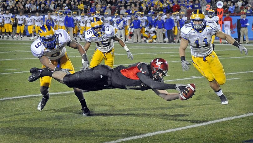 EWU wide receiver Brandon Kaufman stretches out in a full dive to get across the goal line and score on a two yard pass from quarterback Bo Levi Mitchell. The play earned EWU their first touchdown enroute to a 20-19 win in the National Championship game against Delaware in Frisco, Texas on Friday, Jan. 7, 2010. (Christopher Anderson / The Spokesman Review)