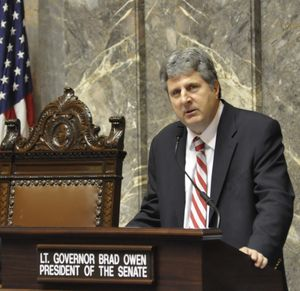 OLYMPIA -- WSU Football Coach Mike Leach addresses the state Senate after a resolution honoring the 1915 football team was adopted. (Jim Camden)