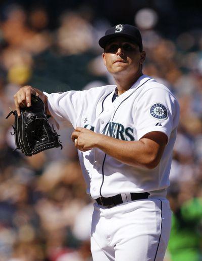 M's starter Jason Vargas allowed nine runs over 52/3 innings Sunday. (Associated Press)