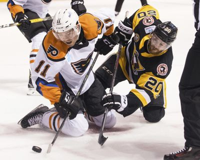 Lehigh Valley Phantoms' Steven Swavely (11) moves the puck past the Wilkes-Barre/Scranton Penguins' Jarrett Burton after a faceoff during an AHL hockey game in March. The American Hockey League has canceled the rest of its season because of the coronavirus pandemic. President and CEO David Andrews announced the league 'has determined that the resumption and completion of the 2019-20 season is not feasible in light of current conditions.' The AHL's Board of Governors made that determination in a conference call Friday, May 8, 2020. (Christopher Dolan / Associated Press)