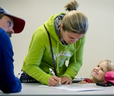 Addison Havel, age 4 of Newman Lake, Wash., beams as her mother, Sherri Havel, 32, registers to vote for the first time, Oct. 29, 2012, at the Spokane County Elections Office.  Monday was the last day to register to participate in the the November 6 general election.  Says Havel