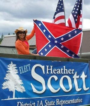 State Rep Heather Scott, R-Blanchard, holding the Confederate flag at Priest Lake Days last year. (Photo from Scott's Facebook page)