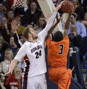 Gonzaga center Przemek Karnowski rejects a shot. (Dan Pelle)