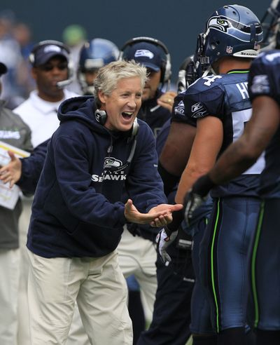 Pete Carroll thanks his defense for holding 49ers on fourth-and-1 last Sunday. (Associated Press)