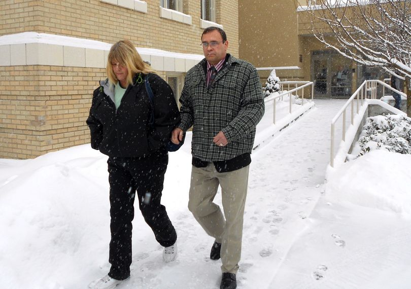 Jonathan Wade Ellington and his girlfriend leave Kootenai County District Court during a break in the opening day of his murder trial on Thursday for a 2006 road rage incident. (Meghann Cuniff / The Spokesman-Review)