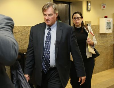 In this Friday, June 30, 2017 file photo, ex-Tulsa police officer Shannon Kepler, left, arrives with his legal team for afternoon testimony in his trial in Tulsa, Okla. (Sue Ogrocki / Associated Press)