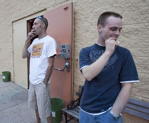 Ronnie Taylor  left, and Brendan Green take a smoking break outside Big John's pool hall in Omaha, Neb.  (Associated Press / The Spokesman-Review)