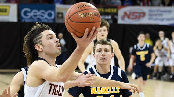 Odessa guard Camden Weber  heads to the basket as Naselle guard Jimmy Strange  defends during Friday's State 1B semifinal  in the Spokane Arena. (Colin Mulvany / The Spokesman-Review)