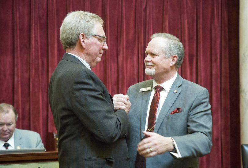 An emotional Sen. Bob Nonini, R-Coeur d'Alene, left, and Sen. Marv Hegedorn, R-Meridian, say their farewells as the Idaho Senate adjourns. Both are not returning next year because they are both candidates for lieutenant governor. The Idaho Legislature adjourned late Wednesday, March 28, 2018. (AP/Idaho Statesman / Katherine Jones)