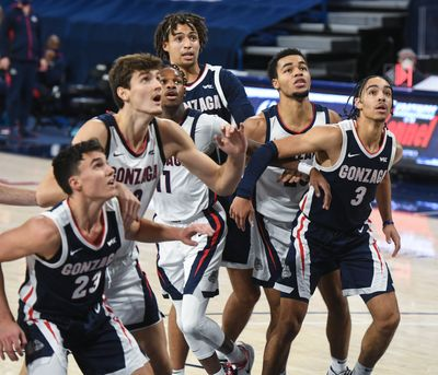Gonzaga players from left, Matthew Lang, Pavel Zakharov, Joel Ayayi, Anton Watson, Colby Brooks and Andrew Nembhard vie for a rebound during Kraziness in the Kennel last November inside a nearly empty McCarthey Athletic Center.  (Dan Pelle/The Spokesman-Review)