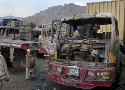 A Pakistani driver examines the burned cabin of a truck torched by militants on the outskirts of Landi Kotal, a town close to the Pakistani tribal area Khyber, on Wednesday.  (Associated Press / The Spokesman-Review)