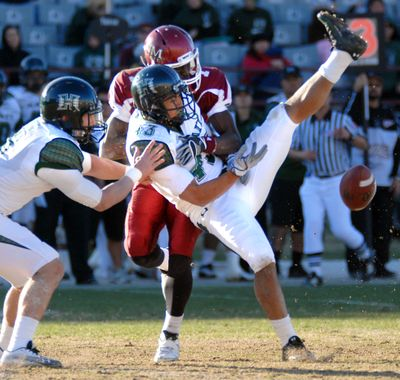 Hawaii's Mana Silva, front center, makes an unsuccessful attempt to intercept the ball against New Mexico State in Hawaii's 59-24 win.  (Associated Press)