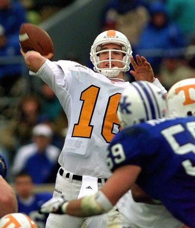 In this Nov. 22, 1997, photo, Peyton Manning launches a pass during the second half of his Tennessee's 59-31 win over Kentucky in an NCAA college football game in Lexington, Ky. Manning and his Southeastern Conference nemesis, former Florida coach Steve Spurrier, will go into the College Football Hall of Fame together. (Ed Reinke / Associated Press)