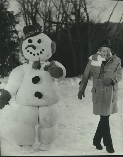 Bing Crosby hangs out with a snowman in this 1973 publicity photo.