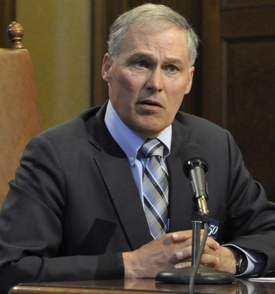 Gov. Jay Inslee speaks with reporters Monday after signing the state's supplemental operating and capital budgets. (Jim Camden / The Spokesman-Review)