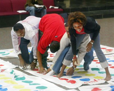 Jacob Jenkins, Ramone Robinson, Nelson Miller and Tairisha Sawyer play Twister in Edwardsville, Illinois, on Sept. 22, 2004. Charles Foley, inventor of Twister, died on July 1, 2013, in St. Louis Park, Minnesota, according to his son, Mark Foley. He was 82. (Wayne Crosslin / AP)