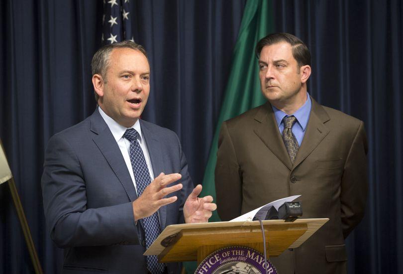 Spokane Mayor David Condon, left, with City Council President Ben Stuckart, announce police Chief Frank Straub's resignation Tuesday at Spokane City Hall. (Colin Mulvany)