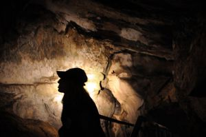 Julia Mathison, an Interpretive Assistant, talks about Gardner Cave at Crawford State Park near Metaline Falls. (Rajah Bose / The Spokesman-Review)