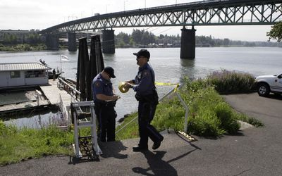 Portland police tape off a dock near Portland's Sellwood Bridge on Saturday. Portland homicide detectives launched an investigation after a 4-year-old boy and 7-year-old girl were found in the Willamette River. The boy had drowned. The children's mother was arrested. (Associated Press / The Spokesman-Review)