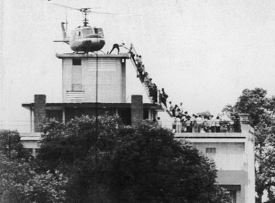 Hubert Van Es took this photo of an Air America helicopter crew member helping evacuees up a ladder April 29, 1975,  before  Saigon fell to  North Vietnamese troops.United Press International (United Press International / The Spokesman-Review)