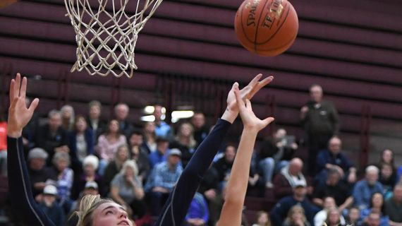 Central Valley forward Michael Pitts (2) and Glacier Peak post Madison Rubino (15) reach for a rebound during a girls 4A regional high school basketball playoff game, Friday, Feb. 28, 2020, at University High School. (Colin Mulvany / The Spokesman-Review)