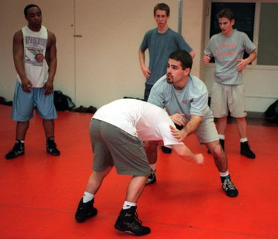 Jason Tebbets works with the Lewis and Clark wrestling team during a 1999 practice. Tebbets has been at Mead for the last 18 years. (SR)
