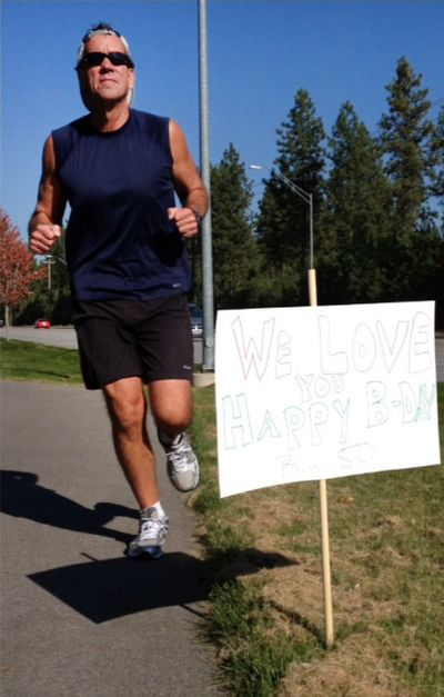 Keith Erickson takes a 12-mile run on his 50th birthday in October. His wife and daughter lined the Coeur d'Alene route with birthday signs.