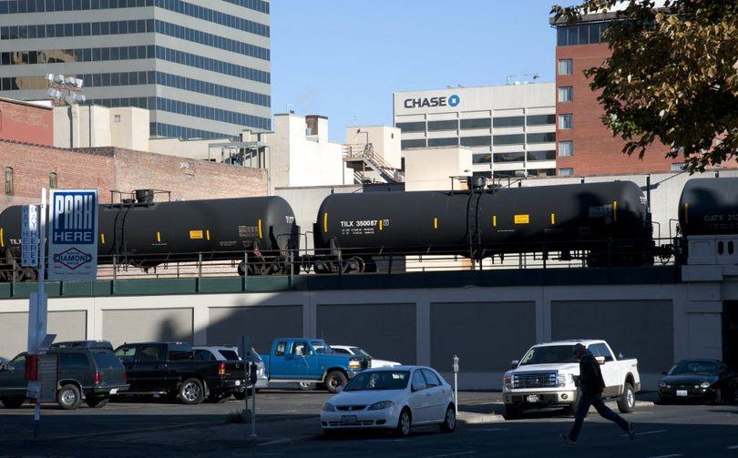 In this Oct. 26, 2014, SR file photo, train cars carring flammable liquids head west through downtown Spokane.  (Dan Pelle / The Spokesman-Review)