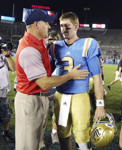 UCLA head coach Jim Mora, left, won't say if quarterback Josh Rosen, right, will definitely play against Cougars. (Reed Saxon / Associated Press)