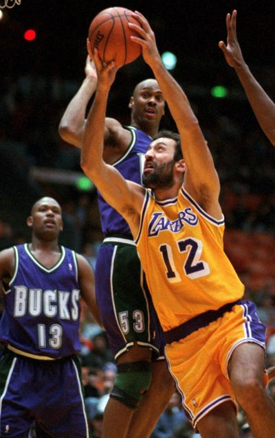 Center Vlade Divac (12) was taken in draft by Lakers in 1989.  (File Associated Press / The Spokesman-Review)