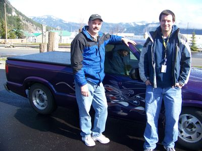 Duane Nightingale, 47, and his commuting buddy, Dave Mellick, 29, with the pickup that they converted to run on electricity.Photo courtesy of Herb Huseland (Photo courtesy of Herb Huseland / The Spokesman-Review)