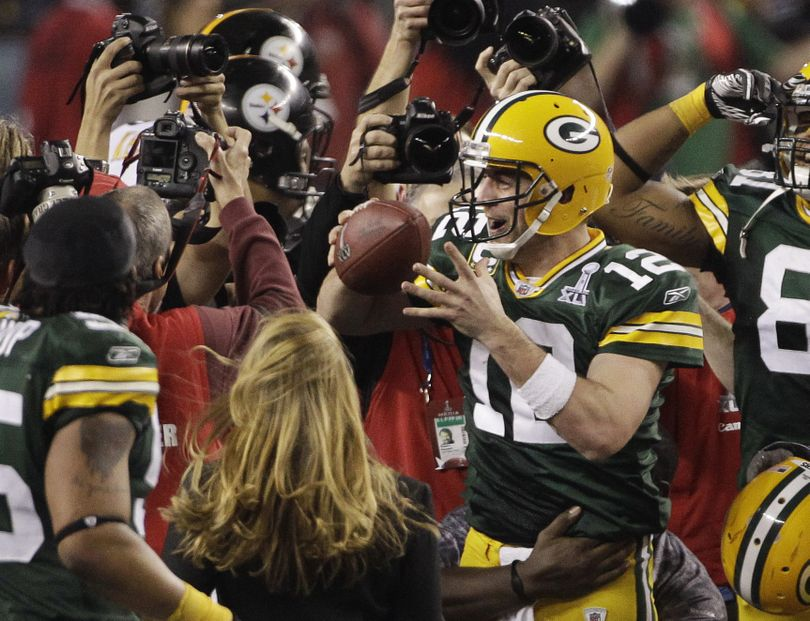 Aaron Rodgers celebrates with teammates after Green Bay's victory over Pittsburgh in Super Bowl XLV.