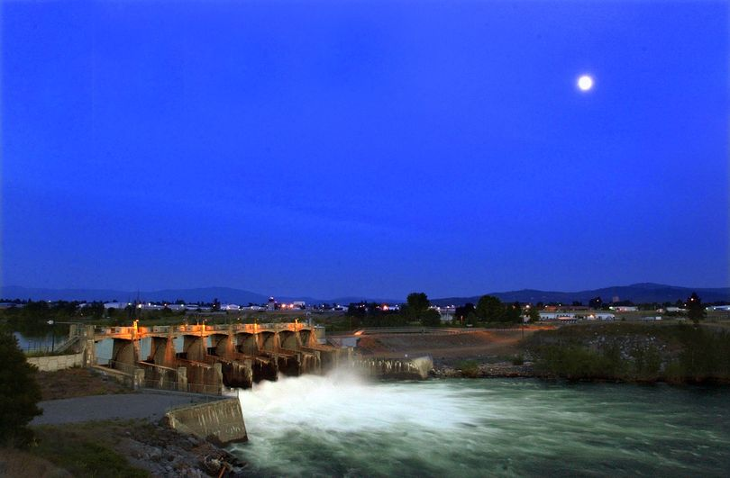 A full moon rises over the Upriver Dam in the Spokane River.  Waste and tailings from over 100 years of mining in the Silver Valley has been carried by the rivers and has piled up behind the dam to the point where the EPA is considering having to dredge out behind the dam to mitigate the contamination.  (Christopher Anderson)
