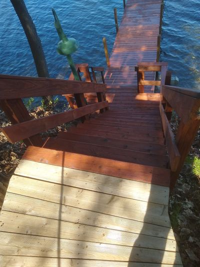 The steps, railing and boat dock are cleaned and sealed. The top walkway is ready for the sealer.  (Tim Carter)