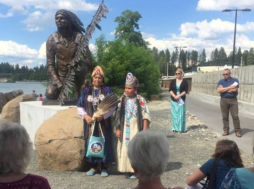 Here's proof that I wasn't lollygagging today. I'm in the right corner (sunglasses), standing next to emcee Jennifer Drake. Kathy Plonka/SR photog is in the lower right corner photographing the event. In the foreground, Jeanie Louis and her granddaughter, Northstar Garvais Lawrence, 10, discuss their famous ancestor, Chief Morris Antelope. (Eden Irgens' Facebook photo)